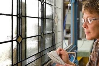 woman painting decorative glass
